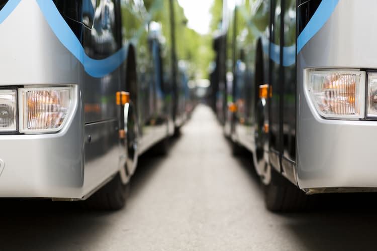 Two buses parked by side