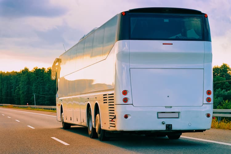 White charter bus on road
