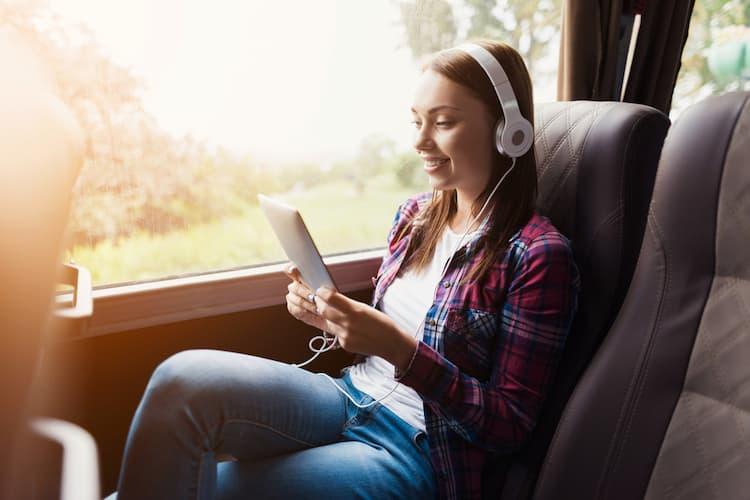 Woman looking at tablet on bus