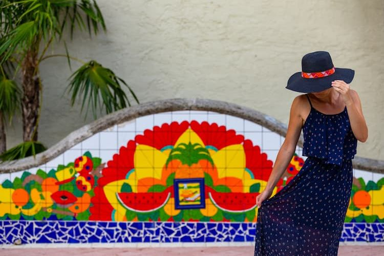 Woman posing in front of colorful wall in Little Havana