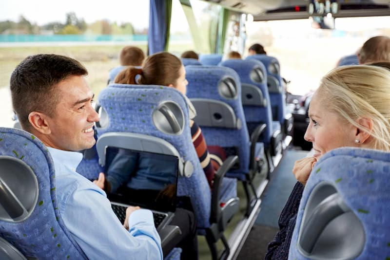 Man and woman talking on charter bus