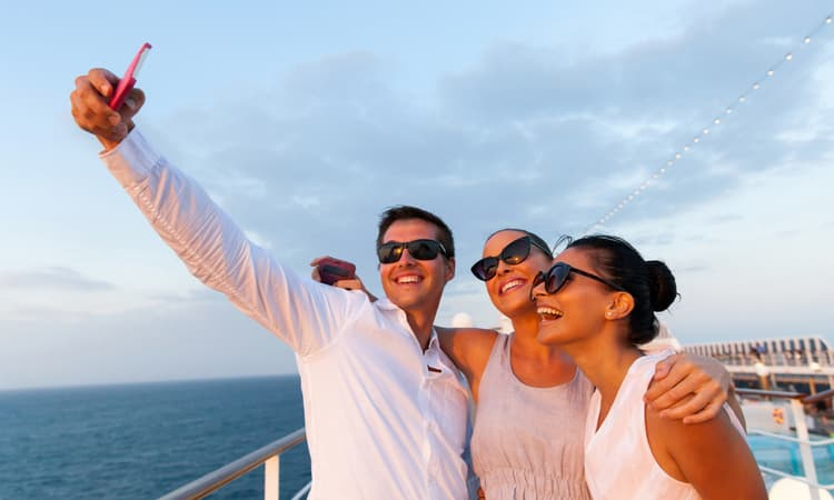 a group of friends taking a selfie on a cruise ship