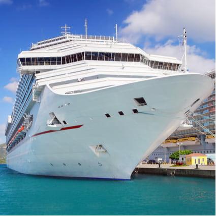 A cruise ship awaits boarding passengers