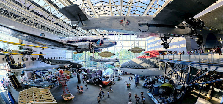 Close-up of planes hanging from museum ceiling