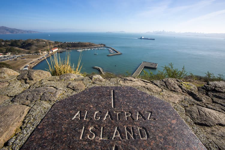 view of the engraved stone on alcatraz island, looking towards the inner bay area