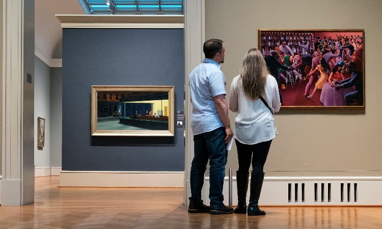 two people view a famous painting at the art institute
