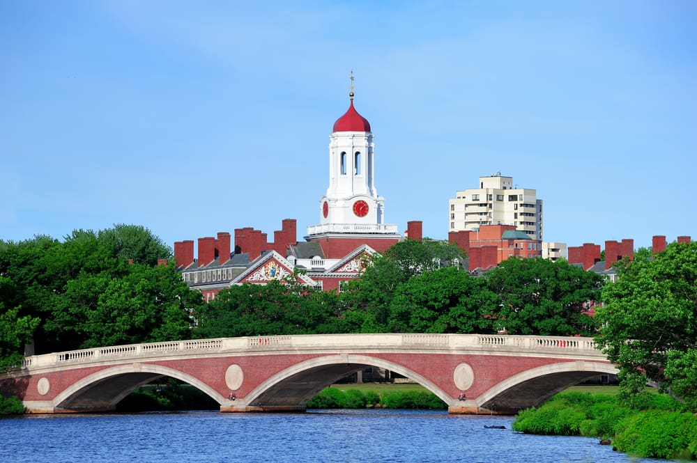 a view of boston college from across the river