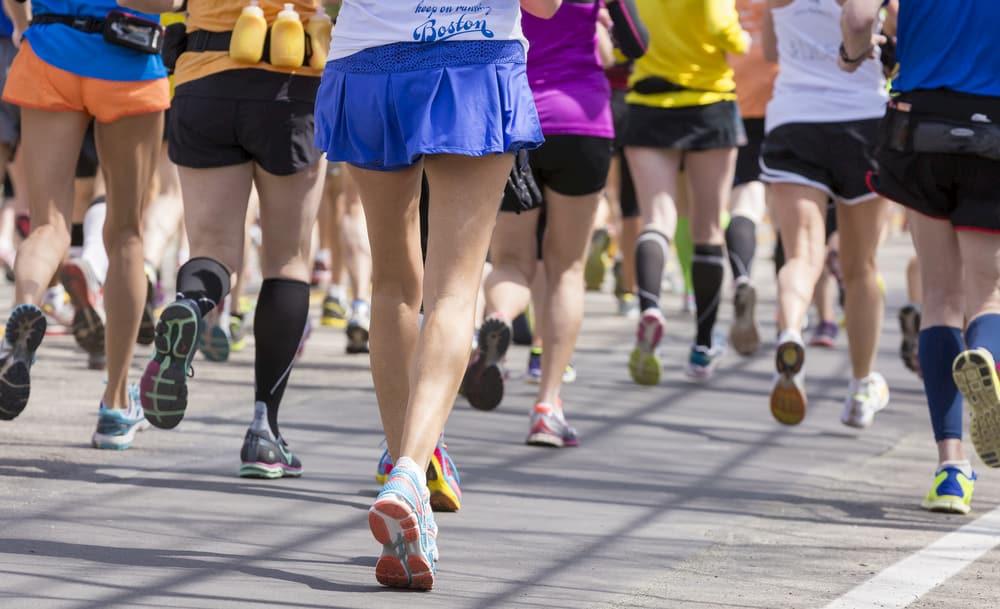 runners participate in the boston marathon