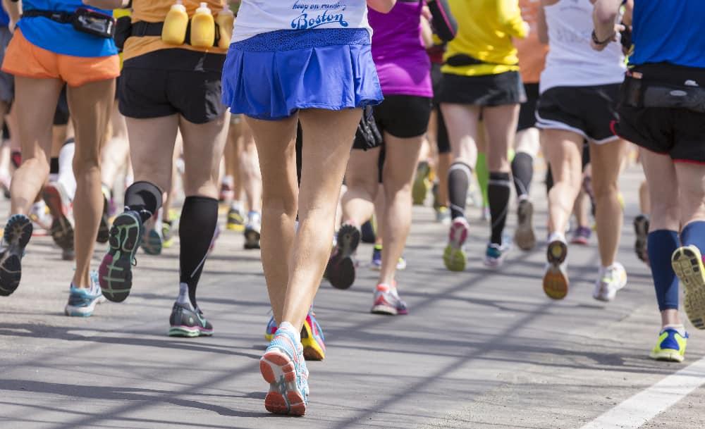 Dozens of runners jog in the Boston Marathon