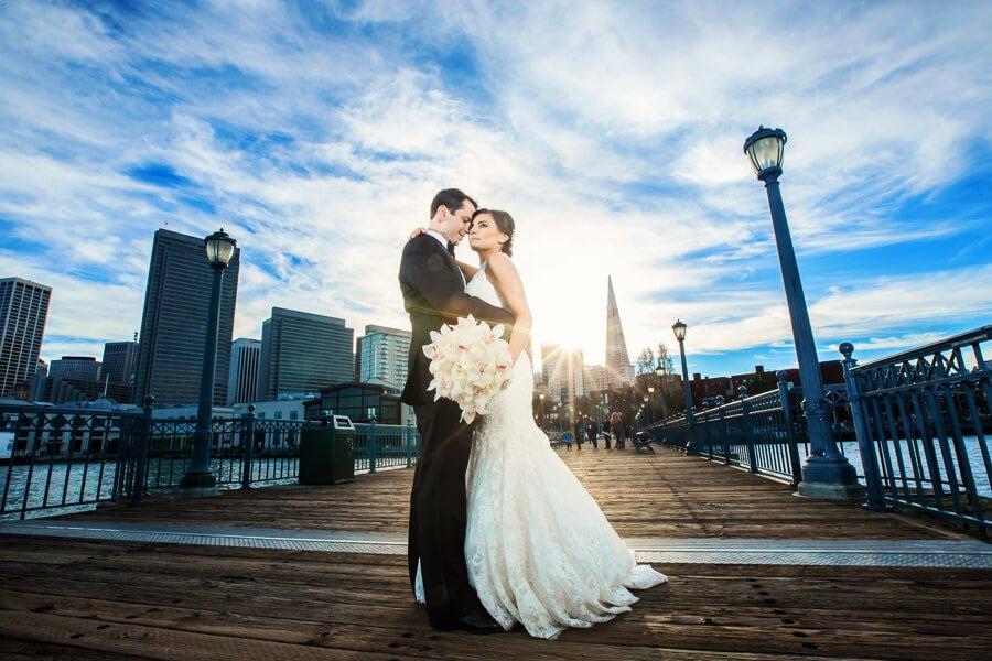 Bride and groom on san francisco pier