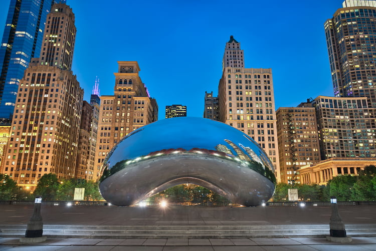Chicago's cloud gate with the city in the background