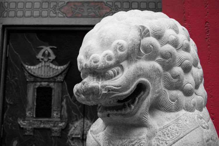 A statue of a lion outside the TCL Chinese Theatre