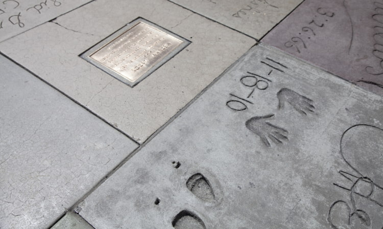 handprints and shoe prints in concrete outside the TCL Chinese Theatre