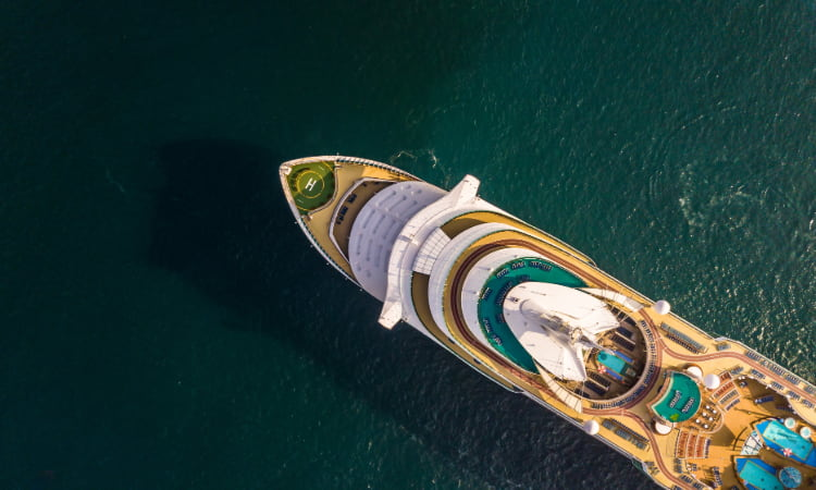 A cruise ship viewed from above in an open ocean
