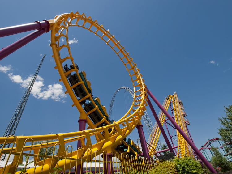 a rollercoaster finishes a loop at elitch gardens