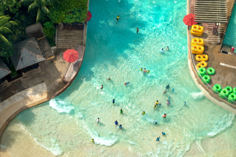 visitors enter a wave pool at Elitch Gardens