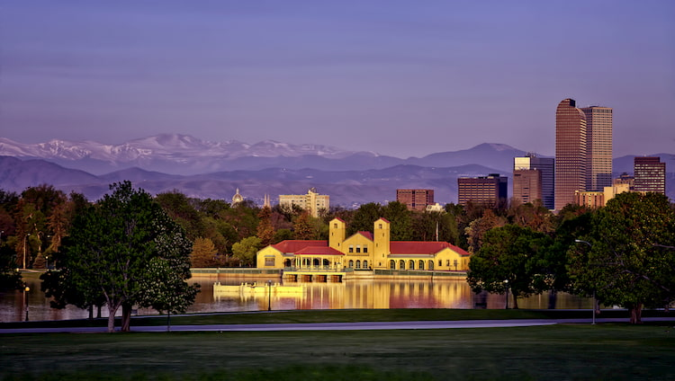 the denver museum of nature and science with mountain backdrop