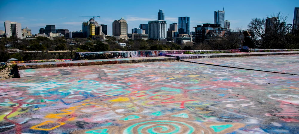view of the Austin skyline from a graffiti'd rooftop