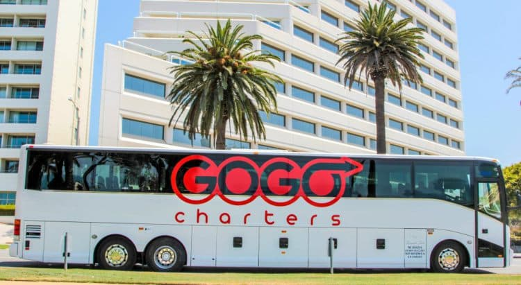 gogo charters bus parked on a city side street