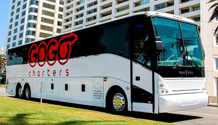 gogo charters bus parked outside building in city