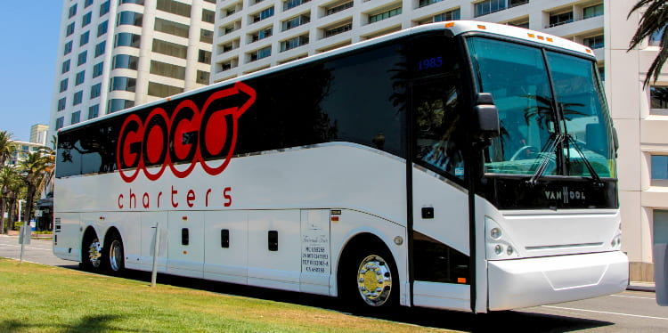 a charter bus with a 'gogo charters' logo on it