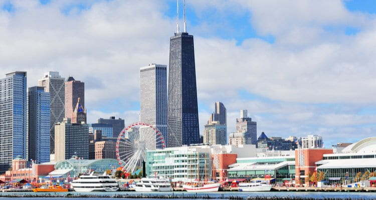 a view of navy pier and the chicago skyline from the water