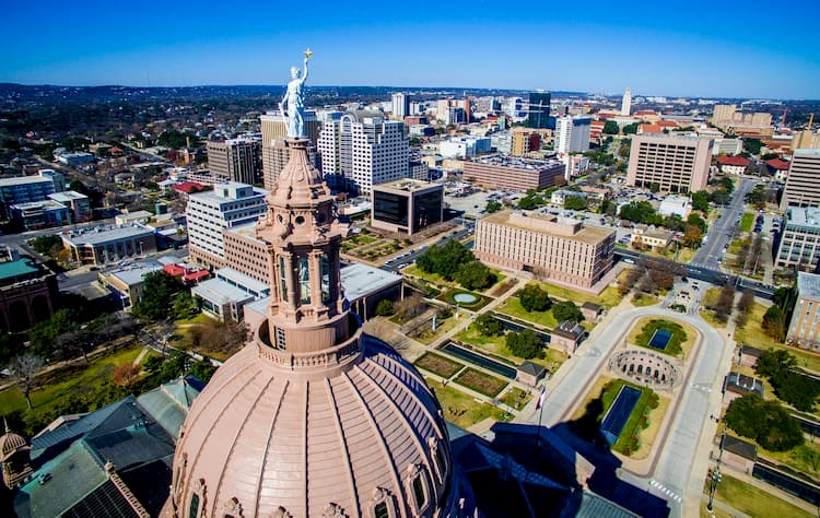 another overview of the texas state capitol, with the rotunda and front pathways