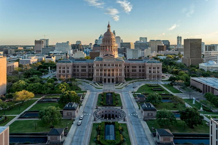 a bird's eye view of the texas state capitol, with a long pathway going to the entrance