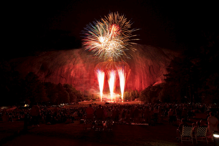 view of the Lasershow Spectacular at night from the Memorial Lawn at Stone Mountain