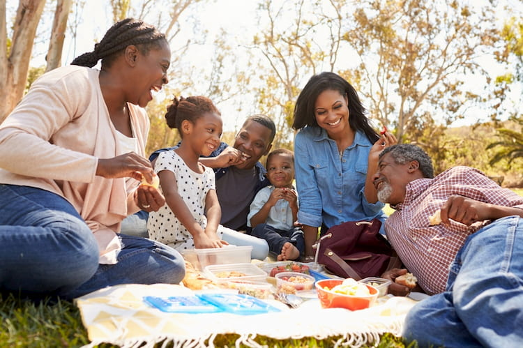 A family enjoys a picnic at the Yellow Daisy Festival