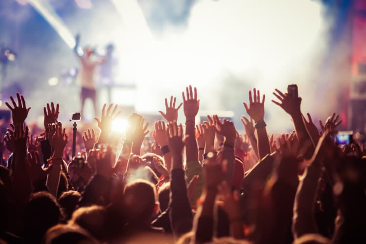 Hands waving in the audience at a concert