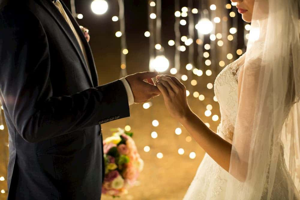 a couple celebrate their wedding in los angeles with lights in the background