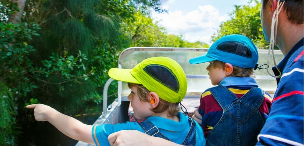 young children and parent on an airboat ride in Everglades National Park