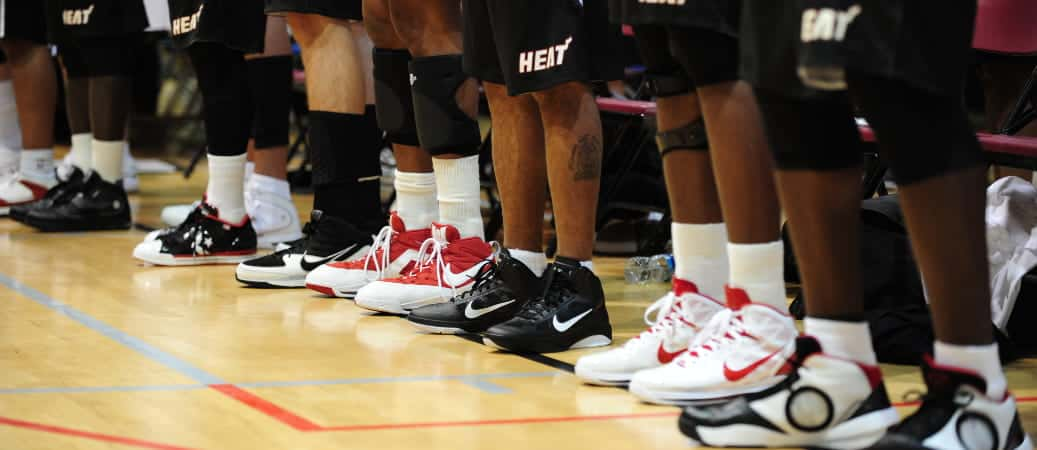 miami heat players standing in a line on the court