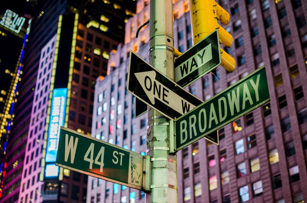 a view of the broadway street sign in new york city