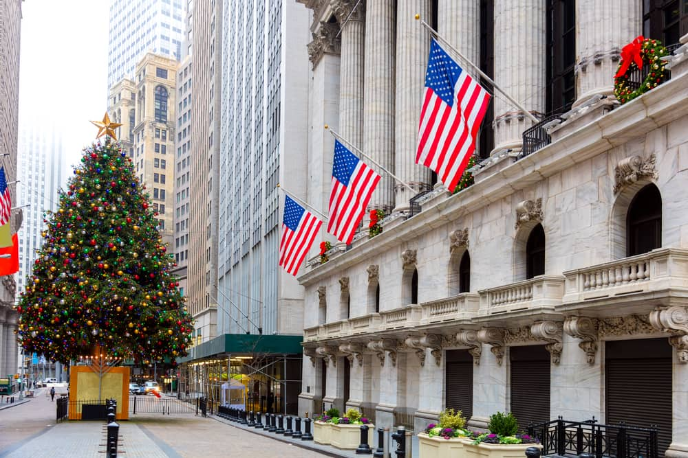 a view of wall street in new york city with holiday decorations and a christmas tree