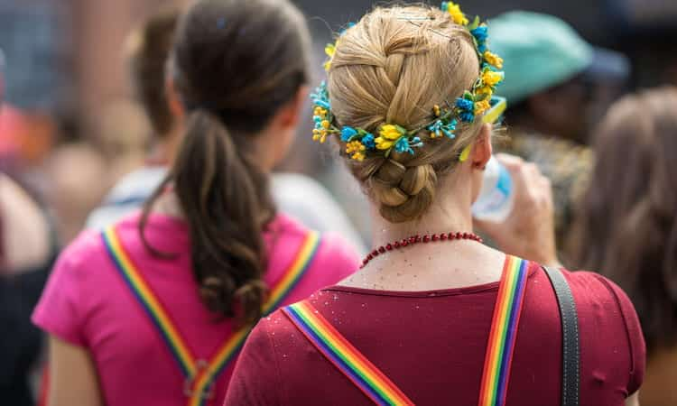 two women with rainbow suspenders at pride