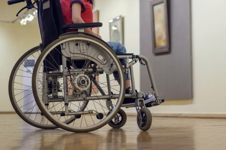 Person in wheelchair visiting art gallery