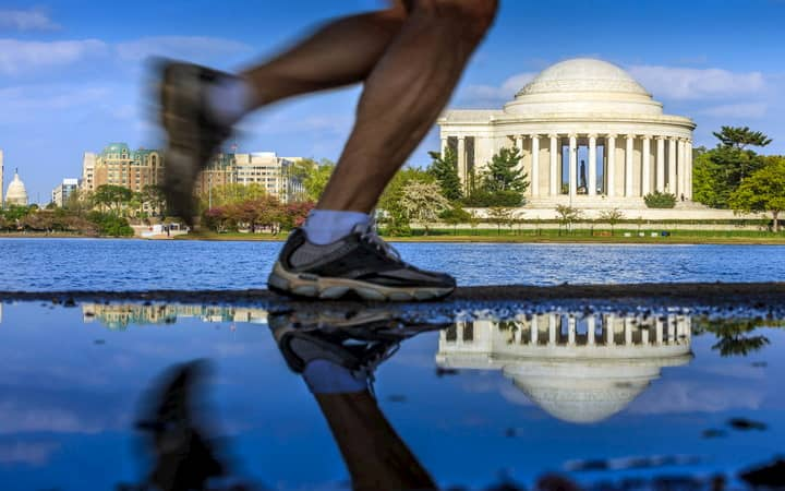 A person running along the National Mall in Washington DC