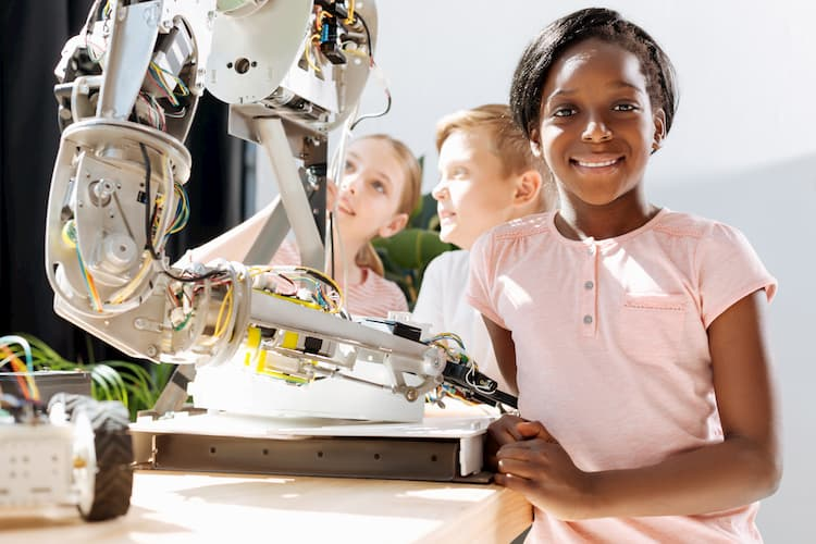 STEM girl standing and smiling at camera