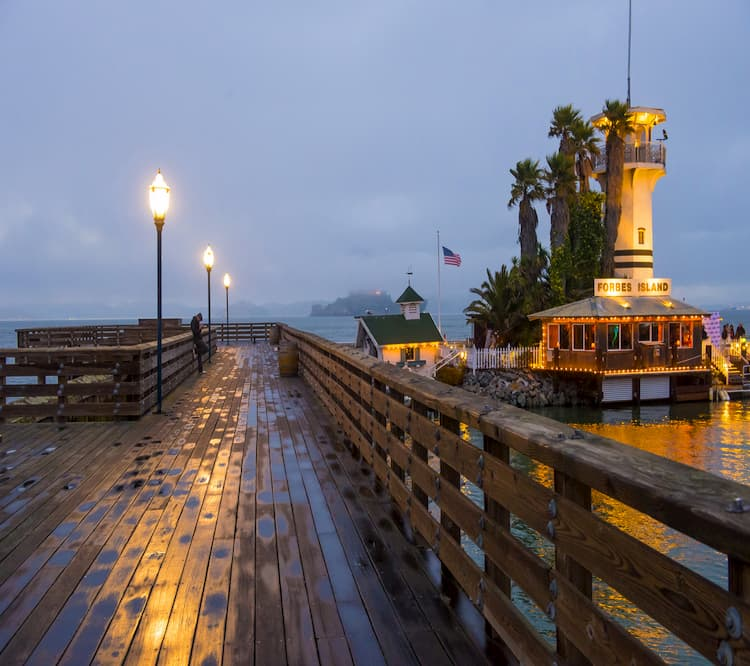 a view of pier 39 at night, after the rain