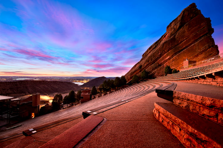 a view of the red rocks park amphitheater at dusk