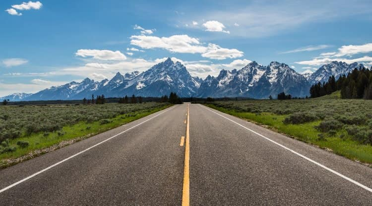 A road surrounded by mountains in Denver, Colorado