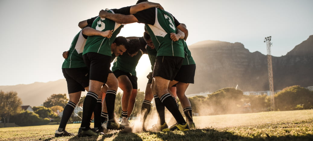 a rugby team huddles together before a game