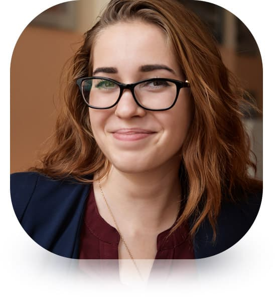 smiling woman with glasses on testimonial