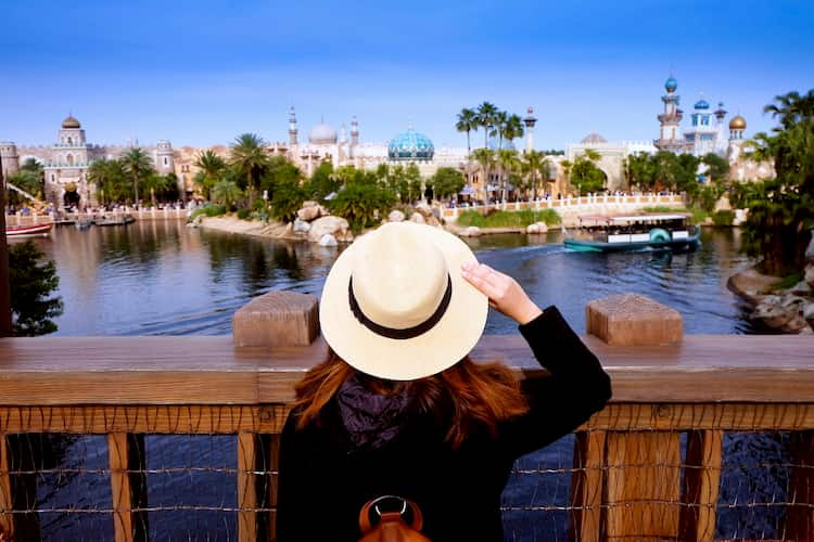Tourist gazing across lake at Universal Orlando